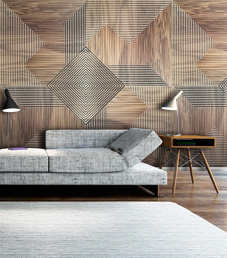 An environment with a wood panel. In the photo, there's a gray couch with a wood wall background. This wood wall is composed of wood patterns with a geometrical shape. Some of the patterns have a greater detail, as others almost look like plain wood.