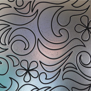 a CARVED mdf panel with a ornamental texture. Painted in silver.