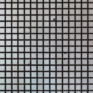 A carved wood panel with a square texture. Each square is finished in silver.