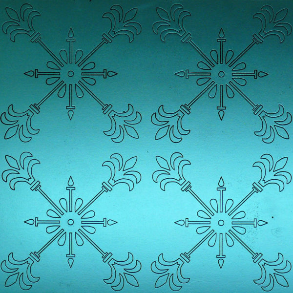 A carved MDF panel with a ornamental texture. Painted in glowing blue tones.