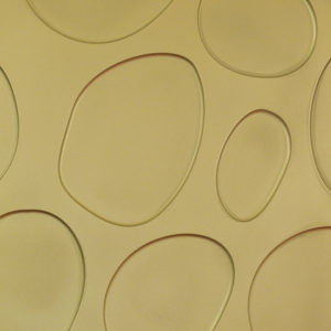 Oval shapes on a carved wood design. Gold / yellow painted.