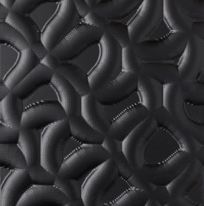 A carved wood panel with an unusual texture. Painted in black.
