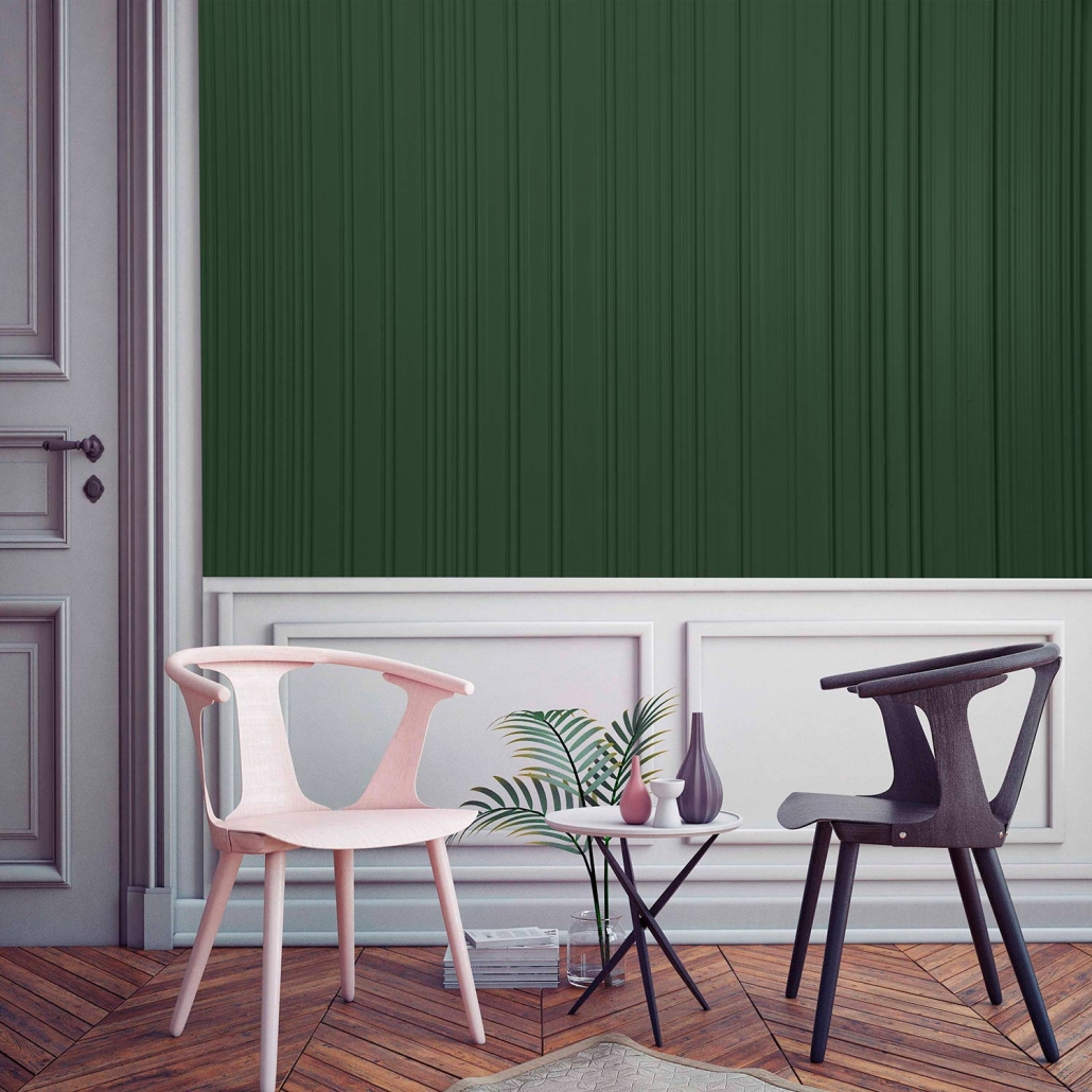 The green panel on the wall belongs to the carved wood collection. This wall has small textured lines, carved in different designs.