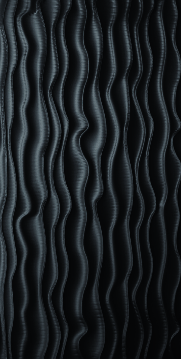 A carved wood panel texture with vertical lines that remind of heat waves.