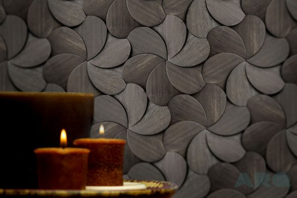 An environment with a decorative wall panel of ours. In this case, the photo shows a Origami Collection product with the reference PL-IP-K02. This Product is a dark-veneer finish wood board with over 300 pieces per square meter. Each piece has a flower like shape, and the pattern feels like each arrangement is placed on top of each other. A decorative wood panel design for application on walls, withc custom-made boards.
