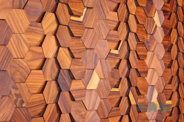 The PL_IW_D01 is a reference of the Origami collection. Composed of individual hexagons with a Iron Wood veneer finish, this panel has different heights, creating a sensation of motion between each hexagon. A decorative wood panel design for application on walls.