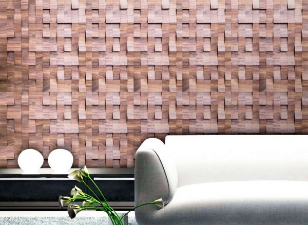 A Veneer panel from the Veneer collection. In the photo, there's an interior environment with a couch, a small closet and plants. The wall, behind the couch, is completely covered with the veneer panel, which has over 400 pieces with different tilted shapes.