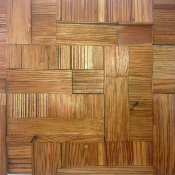 A wood panel, composed by individual wood pieces. Hand-applied with different orientations, this panel doesn't exactly have a pattern but is always a repetition of itself.