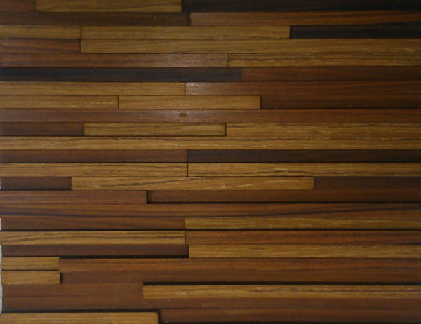A wood panel design with multiple wood strips. Each strip is placed horizontally, with different lengths and heights. This creates a nice game of shadows that plays with the different tonalities.