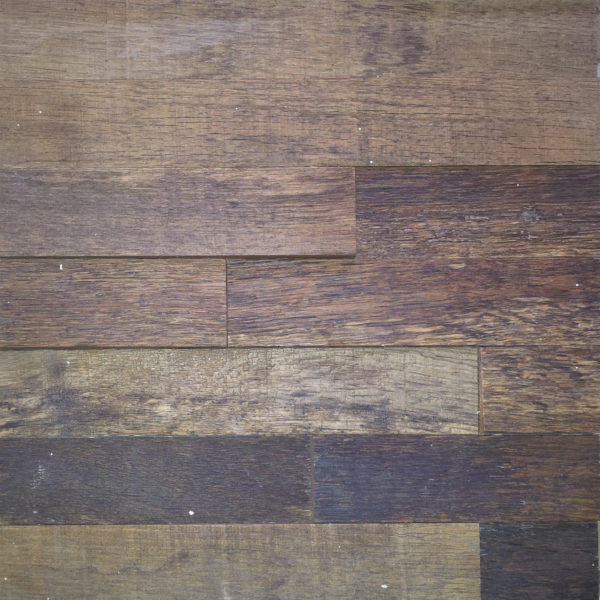 Horizontal wood strips, arranged in a pattern. Each strip has a different height and different tonalities, creating an interesting tridimensional environment.