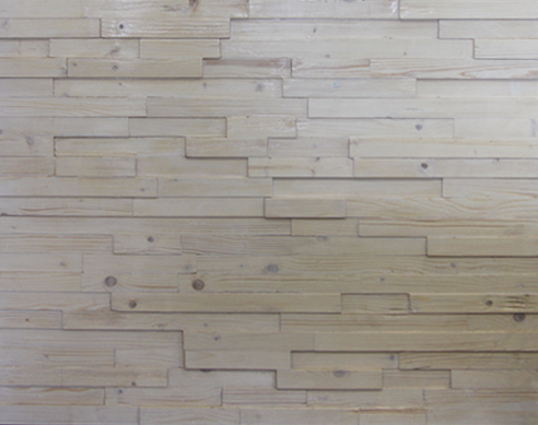 A wood panel with horizontal strips. Each strip has a different height, creating a tridimensional effect. All of the woods are painted in a white patina, which differs a little bit from strip to strip.