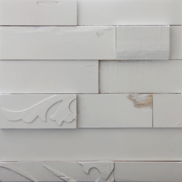 A white painted wood pattern with horizontal strips. Each strip is different than the other, either in size or the pattern on top.