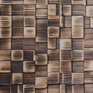 A wood panel with burned squares with varying heights. Each panel is composed of amazing tonalities, some more deep burned and others almost natural.