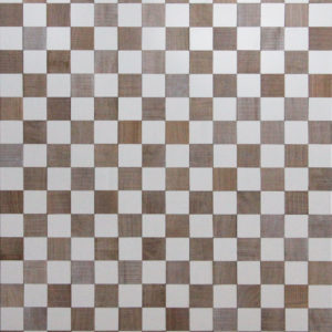 A wood surface that resembles a chess board. The white squares are made from paitned wood, as the other squares are made from reclaimed timber. Each color is organized in a distributed pattern.