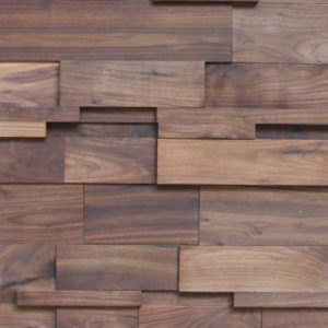 This wood panel is composed of small wood strips in various sizes, some higher than the others. Each wood strip has a wood veneer covering that makes each piece look like natural wood with medium tones.
