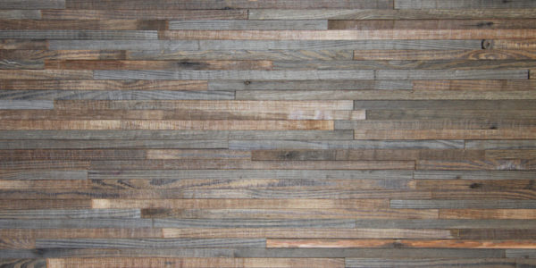 A wood panel, made from horizontally laid wood strips. Each strip is slightly different than the other, as some have darker tonalities.