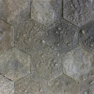 A recycled hexagonal surface with different earths and sediments.